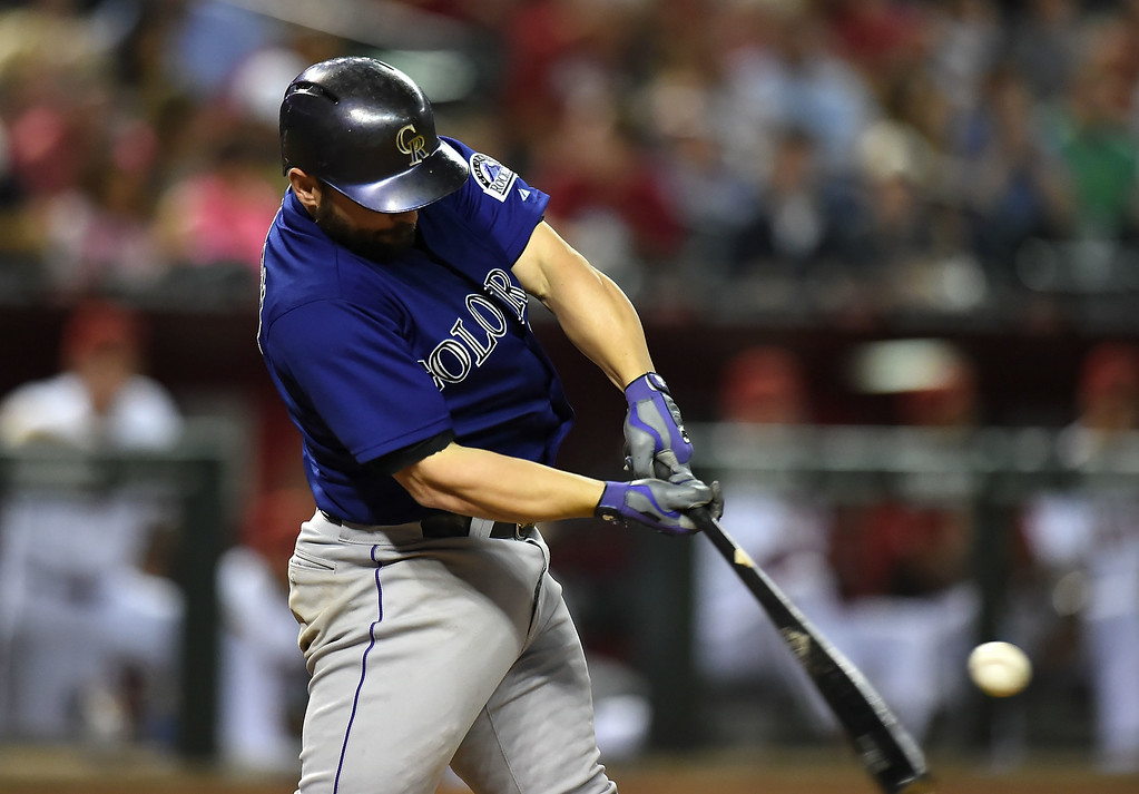 . Michael McKenry #8 of the Colorado Rockies hits a home run in the fifth inning against the Arizona Diamondbacks at Chase Field on August 8, 2014 in Phoenix, Arizona.  (Photo by Norm Hall/Getty Images)