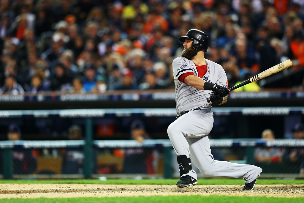 . Mike Napoli #12 of the Boston Red Sox bats in the sixth inning against the Detroit Tigers during Game Four of the American League Championship Series at Comerica Park on October 16, 2013 in Detroit, Michigan.  (Photo by Ronald Martinez/Getty Images)