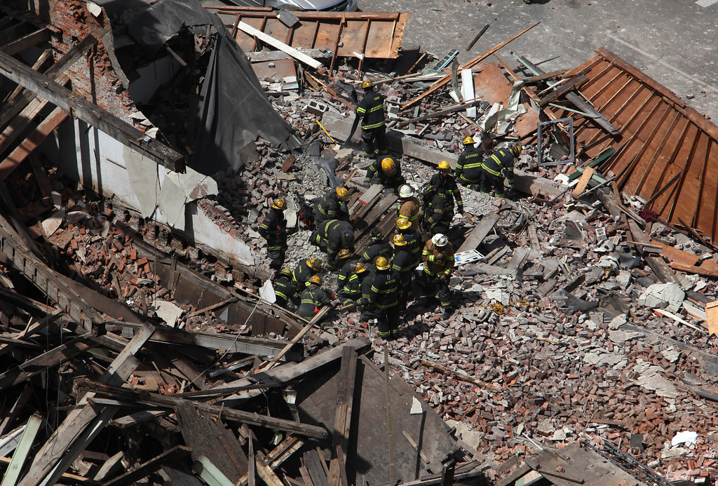 . Rescue personnel work at the scene of a building collapse in  downtown Philadelphia Wednesday June 5, 2013. (AP Photo/Jacqueline Larma)