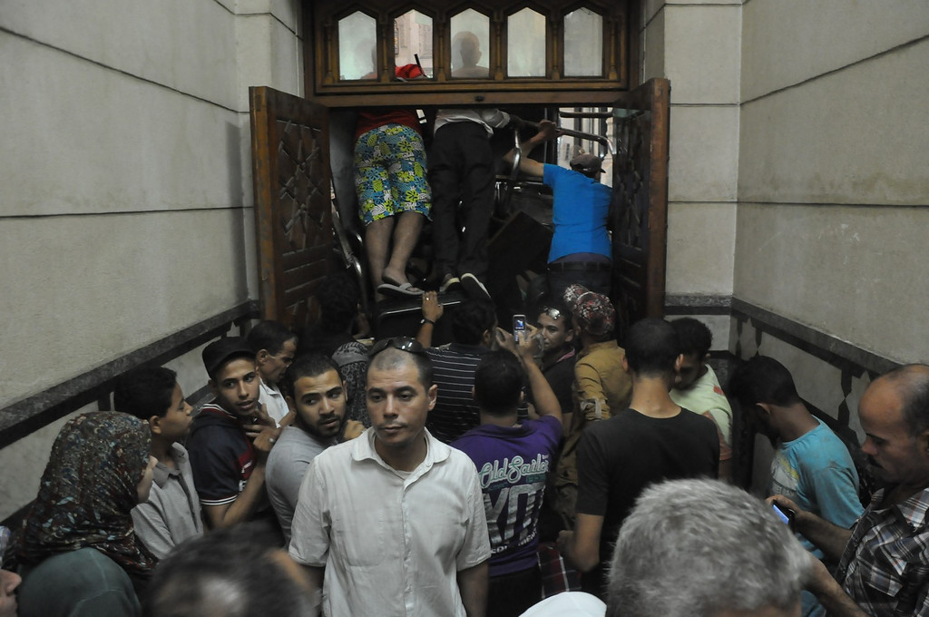 . Pro-Muslim Brotherhood supporters shove furniture against the doors to stop anyone from breaking their way in the al-Fatah mosque, after hundreds of Islamist protesters barricaded themselves inside the mosque overnight, following a day of fierce street battles that left scores of people dead, near Ramses Square in downtown Cairo, Egypt, Saturday, Aug. 17, 2013. Authorities say police in Cairo are negotiating with people barricaded in a mosque and promising them safe passage if they leave. Muslim Brotherhood supporters of Egypt\'s ousted Islamist president are vowing to defy a state of emergency with new protests today, adding to the tension. (AP Photo/Hussein Tallal)