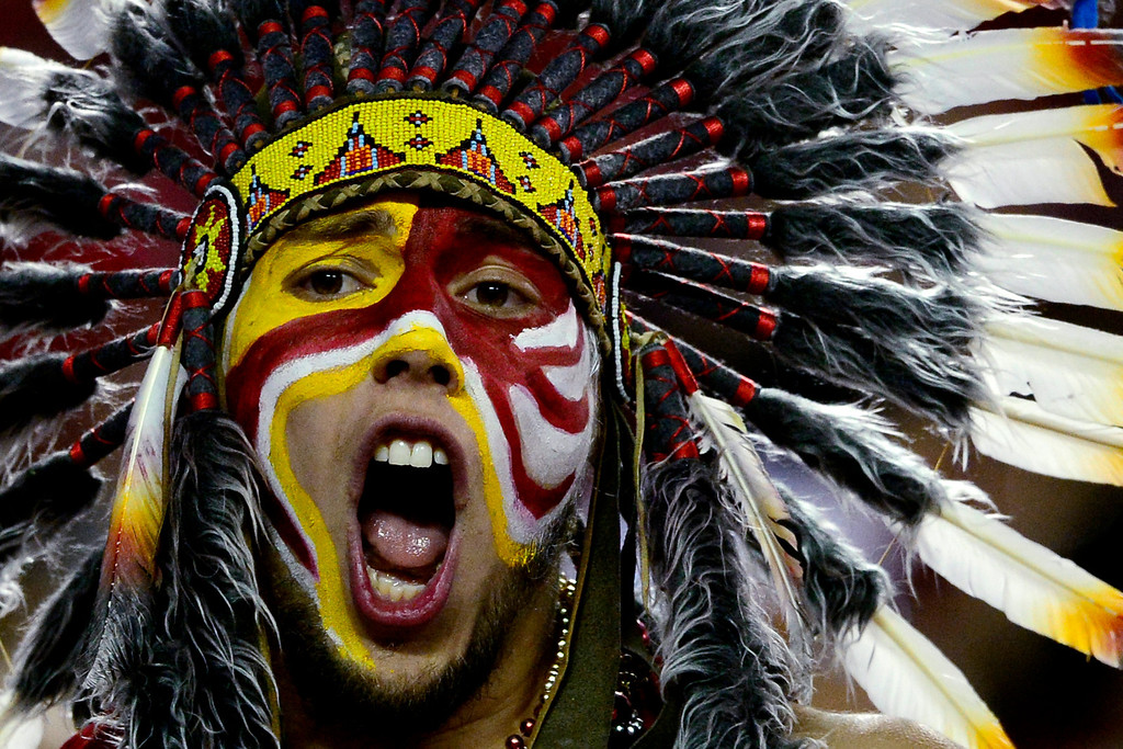 . A Kansas City Chiefs fan cheers his team on against the Denver Broncos during the second half of the Broncos\' 35-28 win at Arrowhead Stadium.   (Photo by AAron Ontiveroz/The Denver Post)