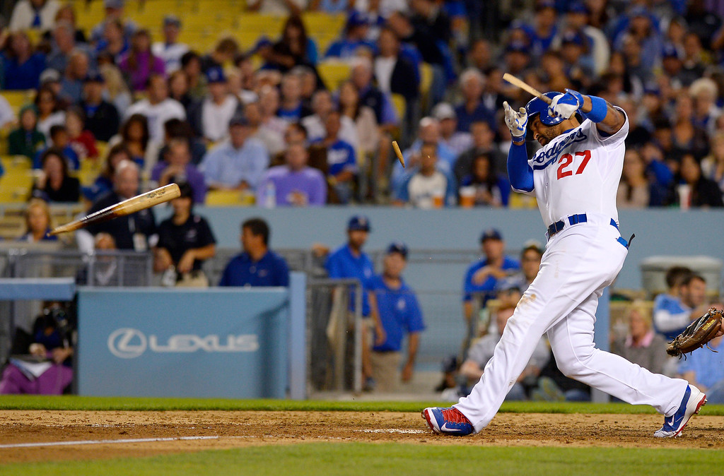 . Los Angeles Dodgers\' Matt Kemp breaks his bat as he flies out during the fourth inning of a baseball game against the Colorado Rockies, Friday, Sept. 27, 2013, in Los Angeles. (AP Photo/Mark J. Terrill)