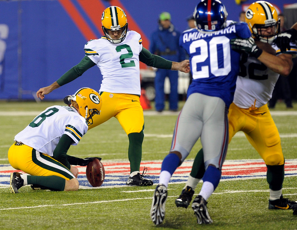 . Green Bay Packers\' Mason Crosby (2) kicks a field goal during the first half of an NFL football game Sunday, Nov. 17, 2013, in East Rutherford, N.J.  (AP Photo/Bill Kostroun)