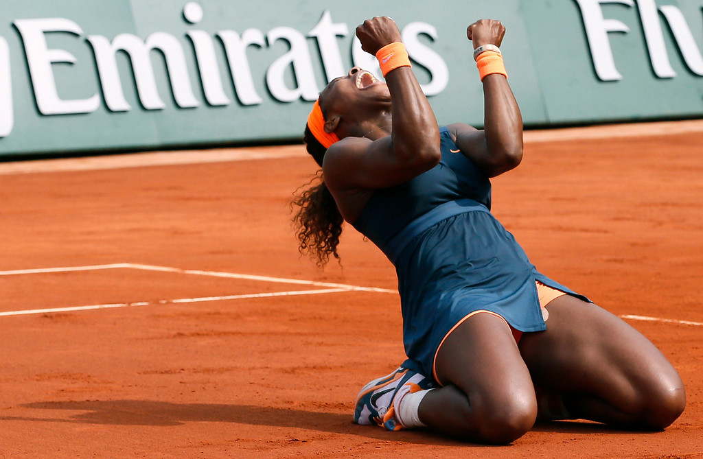 . USA\'s Serena Williams celebrates as she wins the 2013 French tennis Open final against Russia\'s Maria Sharapova at the Roland Garros stadium in Paris on June 8, 2013. AFP PHOTO / PATRICK KOVARIK/AFP/Getty Images