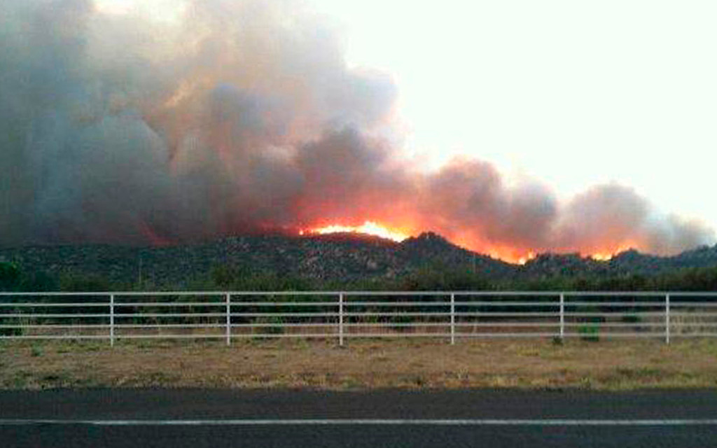 . The Yarnell Hill fire is seen burning in this view from Highway I-17 near Yarnell, Arizona in this handout photo taken June 29, 2013. REUTERS/Arizona State Forestry Division/Handout