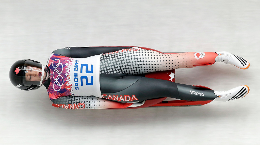 . Arianne Jones of Canada speeds down the track in the third run during the women\'s singles luge competition at the 2014 Winter Olympics, Tuesday, Feb. 11, 2014, in Krasnaya Polyana, Russia. (AP Photo/Michael Sohn)