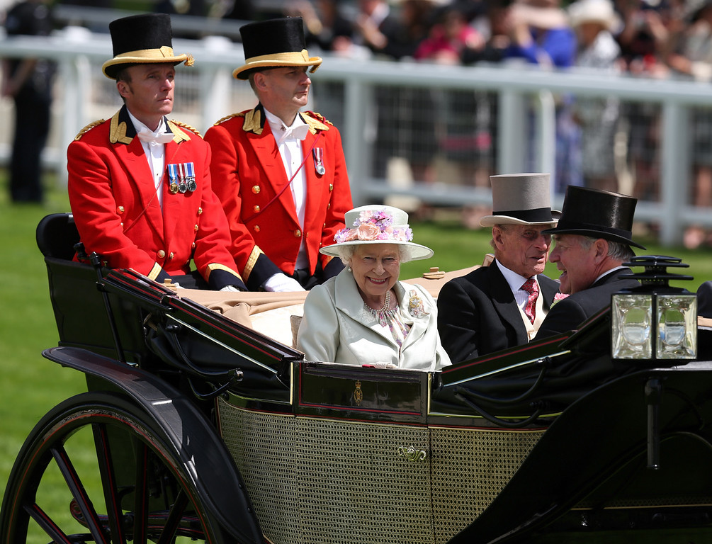 . Queen Elizabeth II and the Duke of Edinburgh in their carriage on day two of Royal Ascot at Ascot Racecourse on June 18, 2014 in Ascot, England. (Photo by Steve Bardens/Getty Images)