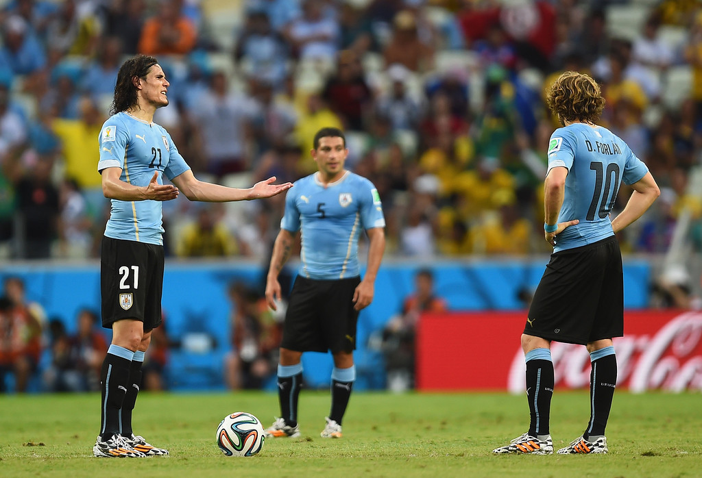 . Edinson Cavani (L) and Diego Forlan of Uruguay wait to kick off after allowing a goal during the 2014 FIFA World Cup Brazil Group D match between Uruguay and Costa Rica at Castelao on June 14, 2014 in Fortaleza, Brazil.  (Photo by Jamie McDonald/Getty Images)
