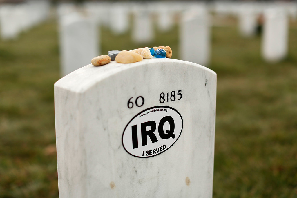 """. A \""""IRQ I served\"""" sticker is seen on a headstone in Section 60 at Arlington National Cemetery in Virginia, March 13, 2013. Section 60 contains graves of soldiers from the wars in Iraq and Afghanistan. Picture taken March 13, 2013. REUTERS/Kevin Lamarque"""