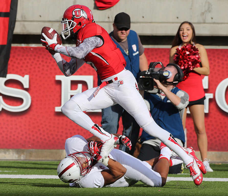 . SALT LAKE CITY, UT - OCTOBER 12: Dres Anderson #6 of the Utah Utes runs the ball for a touchdown after catching a pass over Devon Carrington #5 of the Stanford Cardinal during the first half of an NCAA football game October 12, 2013 at Rice Eccles Stadium in Salt Lake City, Utah. (Photo by George Frey/Getty Images)