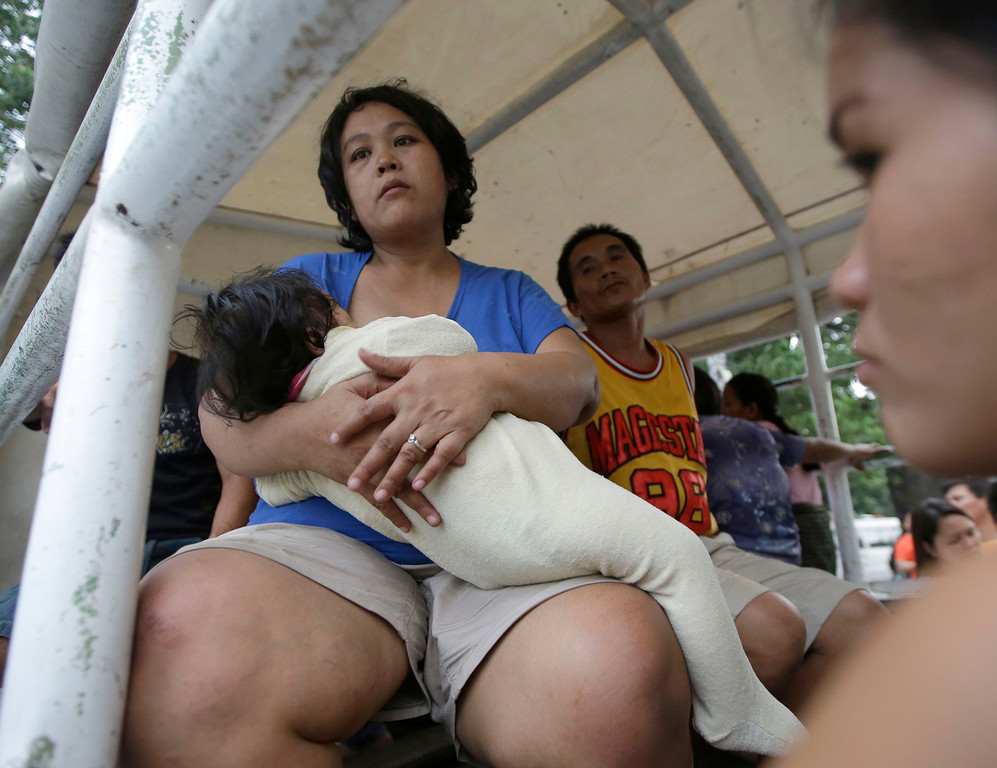 . Earthquake victims wait for treatment at a government hospital following a 7.2-magnitude quake that hit Cebu city in central Philippines Tuesday Oct. 15, 2013. (AP Photo/Bullit Marquez)