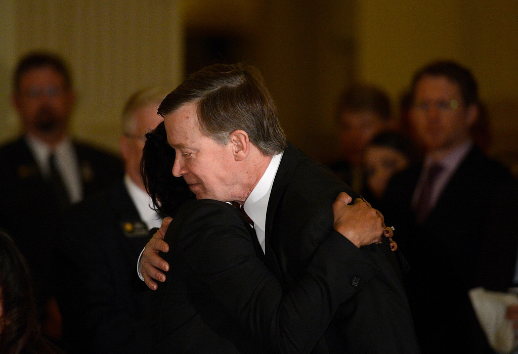 . DENVER, CO. - MARCH 20TH: Colorado Governor John Hickenlooper hugs Kathy Nesbitt, DPA Executive Director during a press conference at the State House in Denver, Colorado on March 20, 2013 to discuss the death of Tom Clements, executive director of the Colorado Department of Corrections. Clements was shot and killed in his Monument, Colorado home on Tuesday, March 19, 2013. (Photo By RJ Sangosti/The Denver Post)
