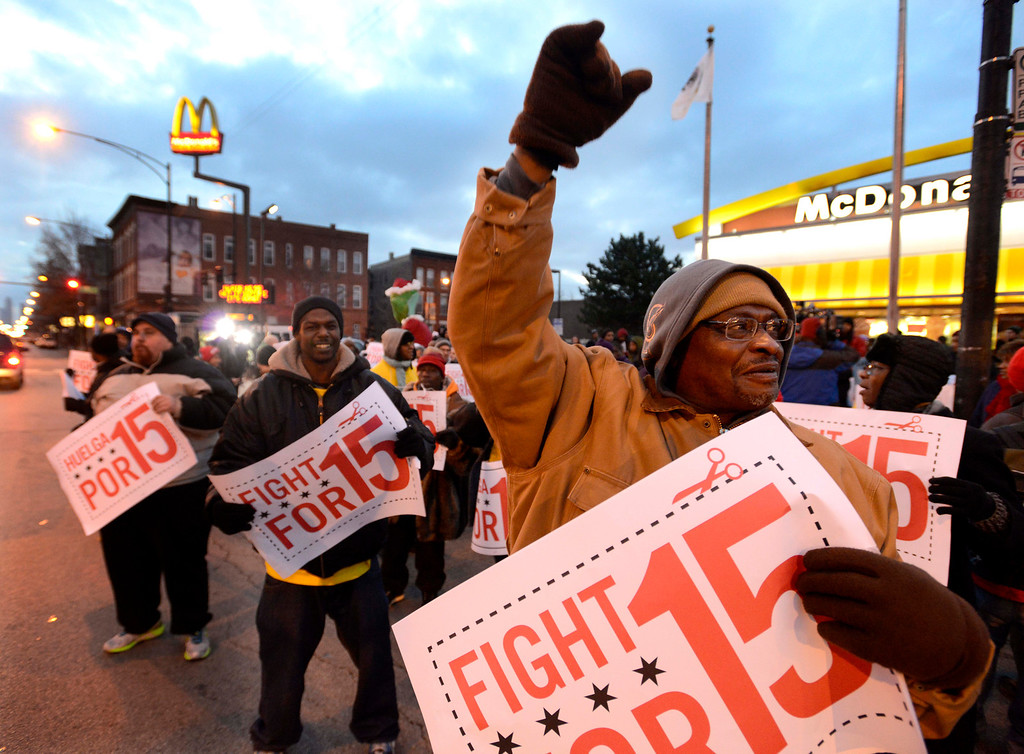 . Demonstrators rally for better wages outside a McDonald\'s restaurant in Chicago, Thursday, Dec. 5, 2013.  (AP Photo/Paul Beaty)
