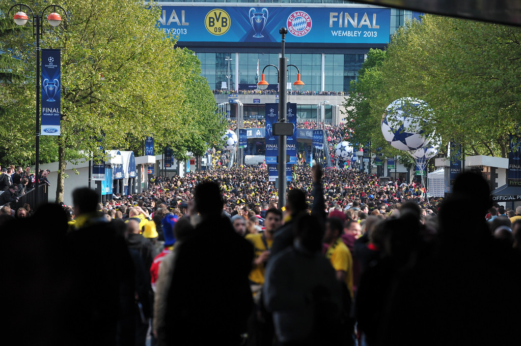 . Fans walk to Wembley Stadium in London on May 25, 2013, ahead the UEFA Champions League football final between Bayern Munich and Borussia Dortmund at Wembley Stadium.  CARL COURT/AFP/Getty Images