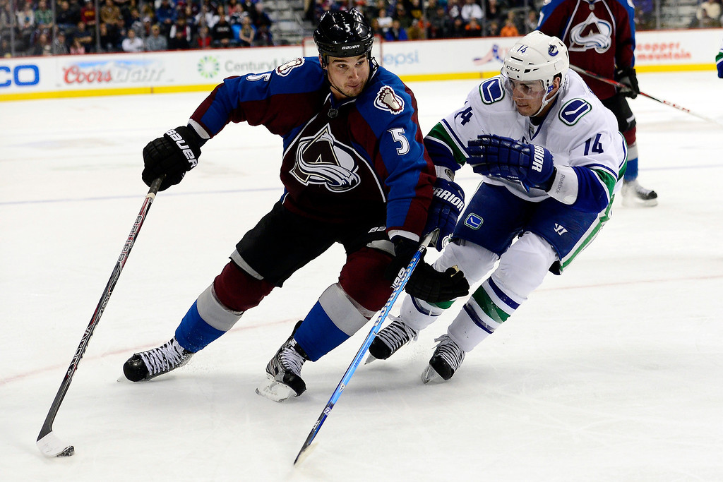 . DENVER, CO - MARCH 24: Alex Burrows (14) of the Vancouver Canucks defends Shane O\'Brien (5) of the Colorado Avalanche during the third period of action. The Colorado Avalanche lost to the Vancouver Canucks 3-2 at the Pepsi Center. (Photo by AAron Ontiveroz/The Denver Post)