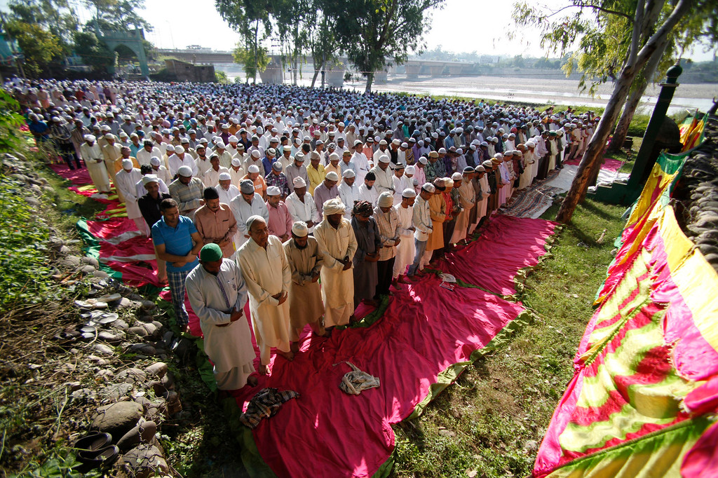 . Indian Muslim men offer prayers during Eid al-Adha, or the Feast of the Sacrifice, in Jammu, India, Wednesday, Oct. 16, 2013. (AP Photo/Channi Anand)