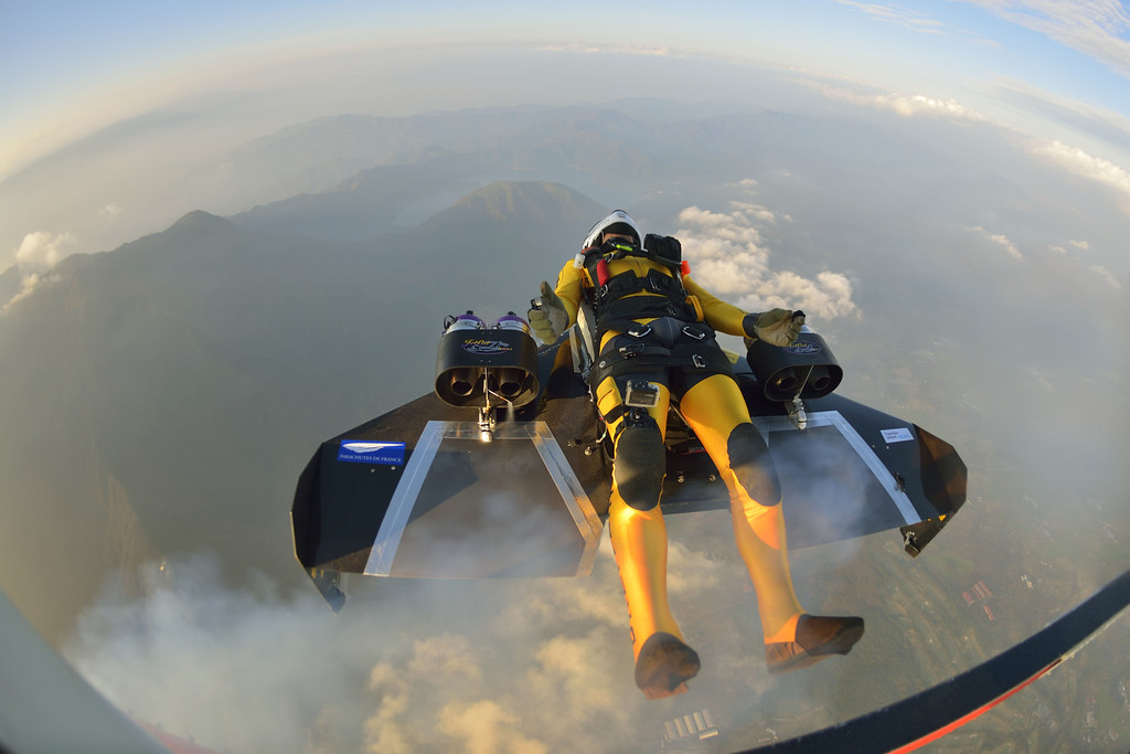 . In this photo taken Friday, Nov. 1, 2013 and provided by Breitling, Yves Rossy, known as the Jetman, jumps from a helicopter near Mount Fuji in Japan. The Swiss aviator jumped from a helicopter at an altitude of 3,600 meters (11,811 feet) and successfully flew the jet-powered carbon-Kevlar Jetwing around the 3,776-meter (12,388-foot)-tall mountain, Japan\'s highest peak, which was recognized as a UNESCO World Heritage site in June. (AP Photo/Katsuhiko Tokunaga, Breitling)