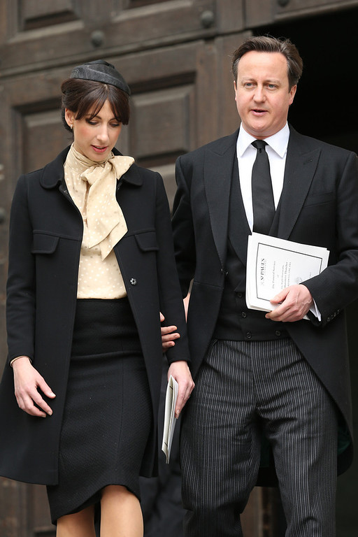 . Samantha Cameron and Prime Minister David Cameron leave the Ceremonial funeral of former British Prime Minister Baroness Thatcher at St Paul\'s Cathedral on April 17, 2013 in London, England. Dignitaries from around the world today join Queen Elizabeth II and Prince Philip, Duke of Edinburgh as the United Kingdom pays tribute to former Prime Minister Baroness Thatcher during a Ceremonial funeral with military honours at St Paul\'s Cathedral. Lady Thatcher, who died last week, was the first British female Prime Minister and served from 1979 to 1990  (Photo by Chris Jackson/Getty Images)