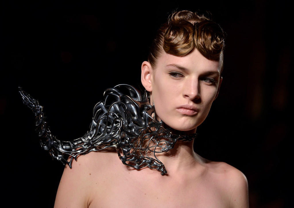 . A model wears a creation by Dutch fashion designer Iris van Herpen for her Spring Summer 2013 Haute Couture fashion collection, presented in Paris, Monday, Jan.21, 2013. (AP Photo/Benjamin Girette)