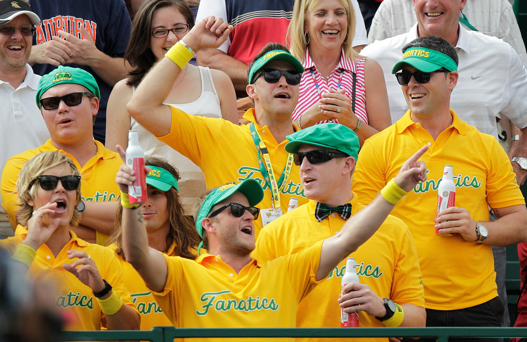. International team fans cheer on the first hole during the foursome matches against the United Sates at the Presidents Cup golf tournament at Muirfield Village Golf Club Friday, Oct. 4, 2013, in Dublin, Ohio. (AP Photo/Jay LaPrete)