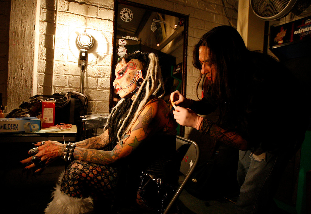 ". Mexican tattoo and body modification artist Maria Jose Cristerna (L), also known as ""Mujer Vampiro\"" (Vampire Woman) is seen backstage before an exhibition in Guadalajara, April 23, 2011. REUTERS/Alejandro Acosta"