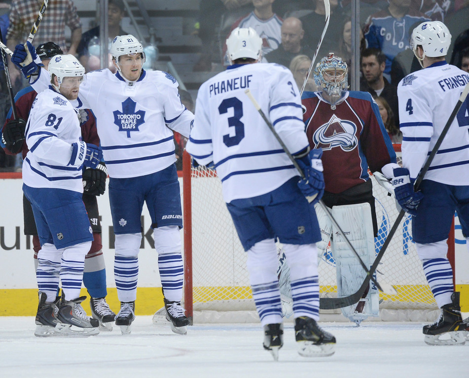 . DENVER, CO. - JANUARY 21:  The Maple Leafs celebrated a goal in front of Avs goaltender Semyon Varlamov in the first period. The Colorado Avalanche hosted the Toronto Maple Leafs Tuesday night, January 21, 2014 at the Pepsi Center. Photo By Karl Gehring/The Denver Post