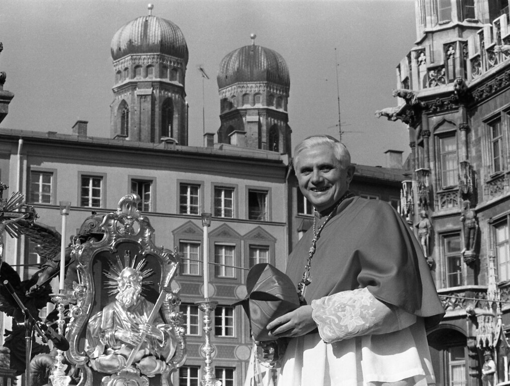 . With the towers of Munich\'s cathedral in the background, Cardinal Joseph Ratzinger bids farewell to the Bavarian believers in downtown Munich, Germany on Sunday, Feb. 28, 1982. A service in the cathedral and a walk through the crowd marked the farewell of the cardinal who will head the Congregation of Faith in the Vatican. (AP Photo/Dieter Endlicher)