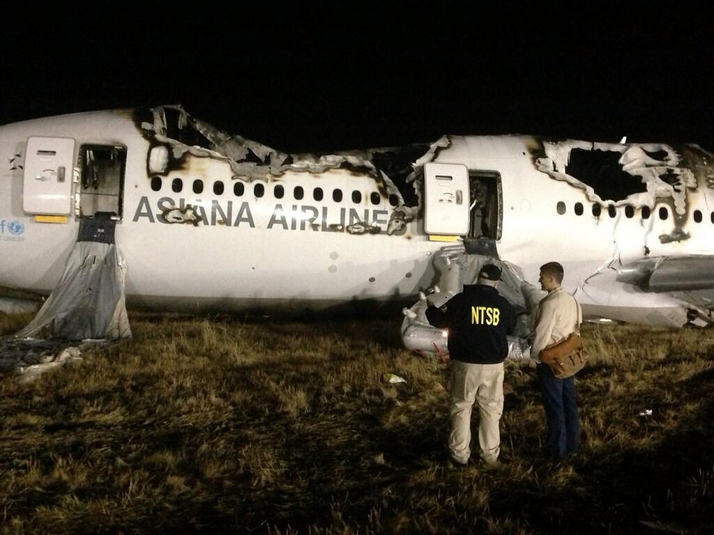. In this photo provided by the National Transportation Security Board (NTSB), NTSB investigators conduct a first site assessment overnight of the Asiana Airlines flight 214 that crashed at the San Francisco International Airport in San Francisco, Saturday, July 6, 2013. The Asiana Airlines Boeing 777 crashed while landing after a 10-hour-plus flight from Seoul, South Korea. The flight originated in Shanghai and stopped in Seoul before the long trek to San Francisco. (AP Photo/NTSB)