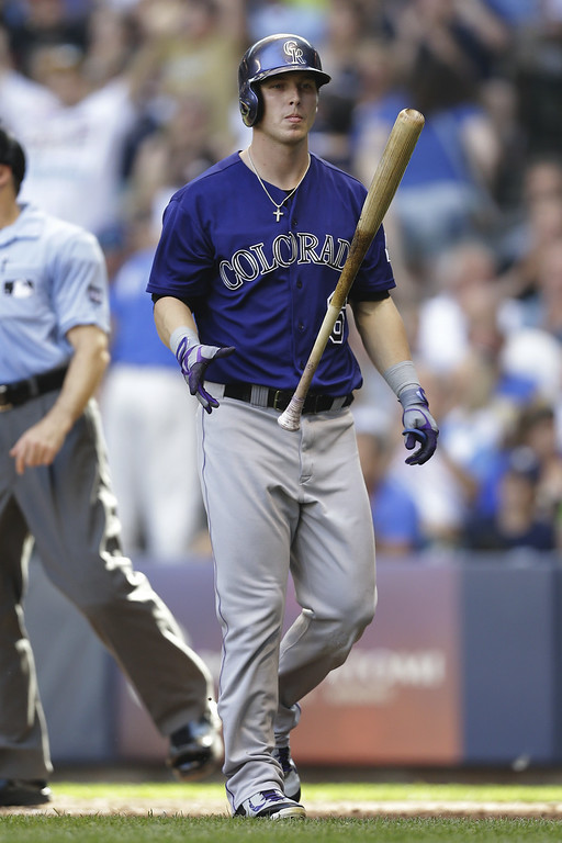 . MILWAUKEE, WI - JUNE 28: Corey Dickerson #6 of the Colorado Rockies flips his bat after striking out in the top of the sixth inning against the Milwaukee Brewers at Miller Park on June 28, 2014 in Milwaukee, Wisconsin. (Photo by Mike McGinnis/Getty Images)