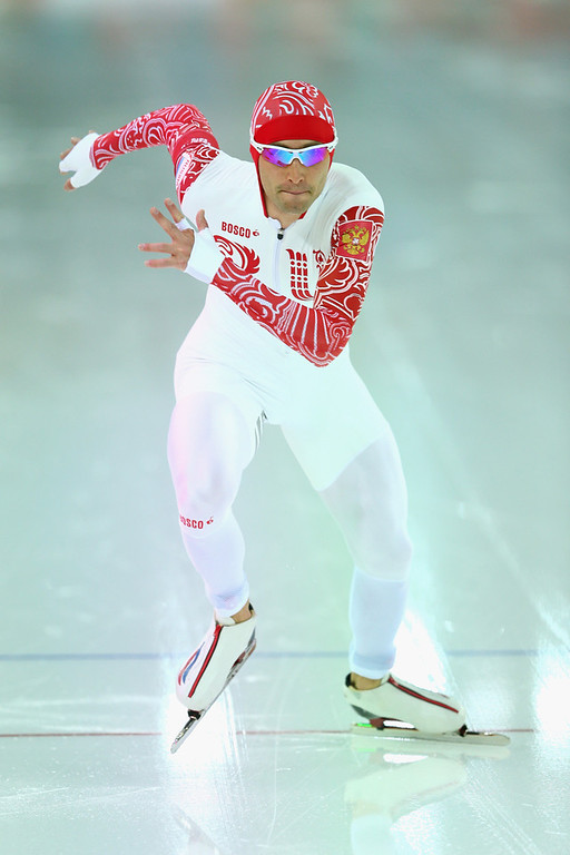 . Aleksandr Rumyantsev of Russia dashes during the Men\'s 5000m Speed Skating event during day 1 of the Sochi 2014 Winter Olympics at Adler Arena Skating Center on February 8, 2014 in Sochi, Russia.  (Photo by Paul Gilham/Getty Images)