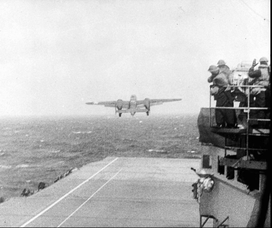 . One of a group of sixteen U.S. Army Air Corps B-25 bombers leaves the deck of the USS Hornet sailing 700 miles off the coast of Japan for a suprise attack on Tokyo on April 18, 1942, by Maj. Gen. James Doolittle and his crewmen. The carrier-based bombing raid on the mainland was a psychological blow to Japanese militarists and may have led to their decision to launch the Battle of Midway, Japan\'s worst naval defeat of the war. (AP Photo/File)