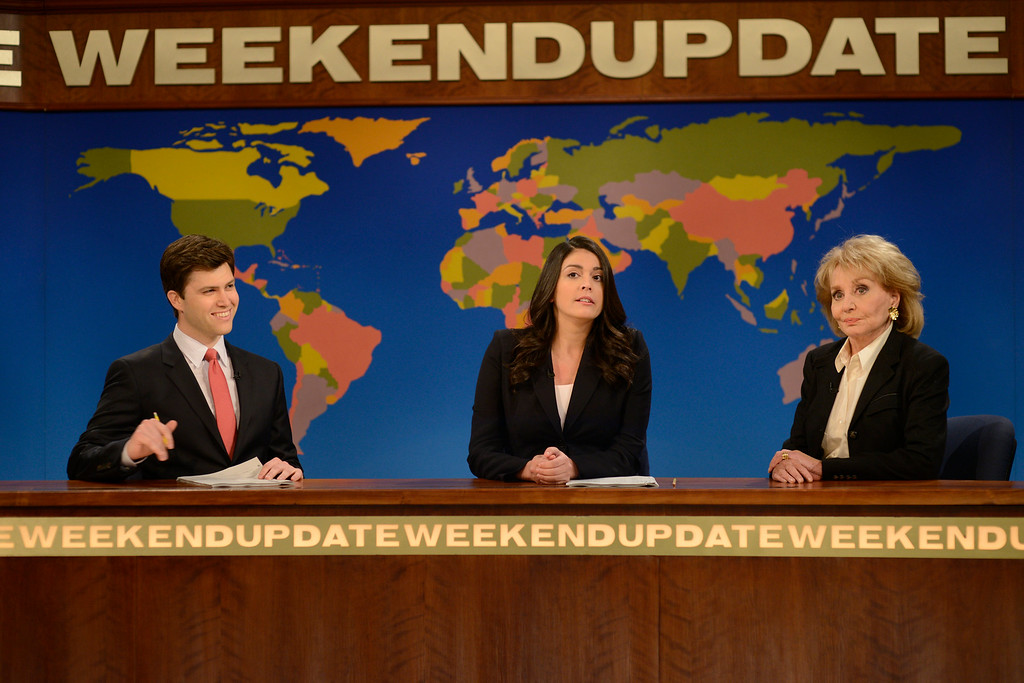 """. This May 10, 2014 photo released by NBC shows cast members Colin Jost, left, and Cecily Strong, center, with TV personality Barbara Walters who made an appearance on the Weekend Update segment of \""""Saturday Night Live,\"""" in New York. On Friday, May 16, 2014, capping a spectacular half-century run she began as the so-called \""""Today\"""" Girl, Walters will exit ABC\'s \""""The View.\"""" Behind the scenes she will remain as an executive producer of the New York-based talk show she created 17 years ago, and make ABC News appearances as events warrant and stories catch her interest. Walters has often been parodied on the weekly sketch comedy series. (AP Photo/NBC, Dana Edelson)"""