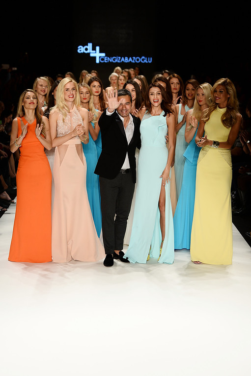. Fashion designer Cengiz Abazoglu (C) and models walk the runway at the ADL & Cengiz Abazoglu show during Mercedes-Benz Fashion Week Istanbul s/s 2014 presented by American Express on October 8, 2013 in Istanbul, Turkey.  (Photo by Ian Gavan/Getty Images for IMG)