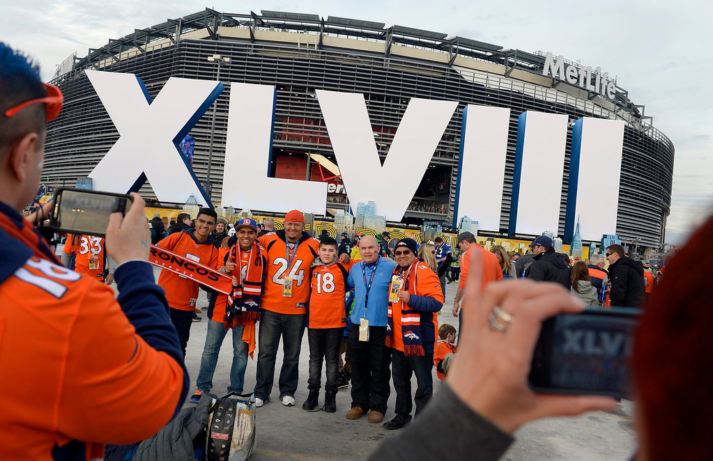 . Arturo Vargas (right side of the group) and his family and friends all from Aurora, Colorado have their photo taken outside of the stadium prior to the game.  The Denver Broncos vs the Seattle Seahawks in Super Bowl XLVIII at MetLife Stadium in East Rutherford, New Jersey Sunday, February 2, 2014. (Photo by Craig Walker/The Denver Post)