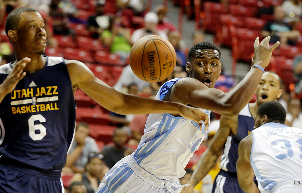 . Utah Jazz\'s Rodney Hood (6) and Denver Nuggets\' Quincy Miller (30) reach for a loose ball during the first half of an NBA summer league basketball game Tuesday, July 15, 2014, in Las Vegas. (AP Photo/Isaac Brekken)