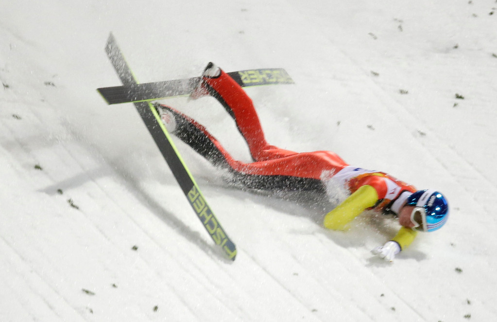. Germany\'s Severin Freund falls during the men\'s normal hill ski jumping final at the 2014 Winter Olympics, Sunday, Feb. 9, 2014, in Krasnaya Polyana, Russia. (AP Photo/Gregorio Borgia)