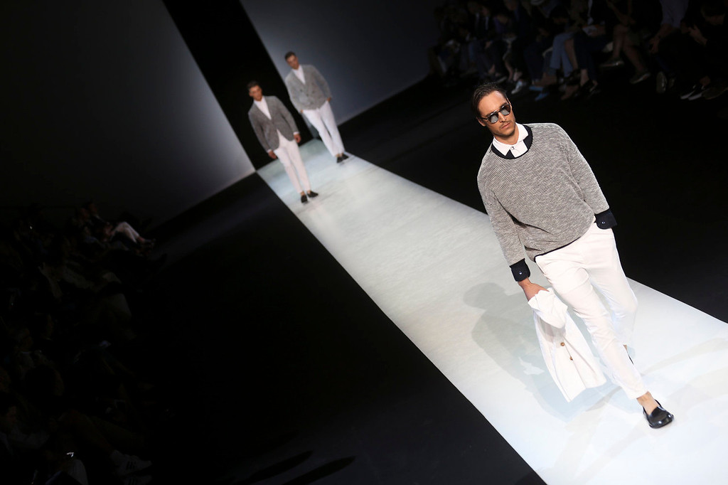 . Models wear creations for Giorgio Armani men\'s Spring-Summer 2014 collection, part of the Milan Fashion Week, unveiled in Milan, Italy, Tuesday, June 25, 2013.  (AP Photo/Luca Bruno)