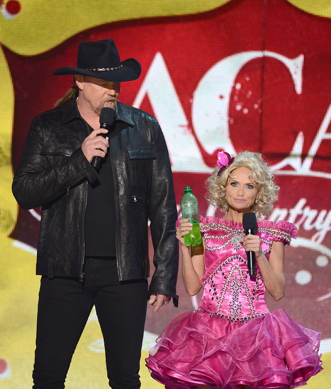 . LAS VEGAS, NV - DECEMBER 10:  Hosts Trace Adkins (L) and Kristin Chenoweth speak onstage during the 2012 American Country Awards at the Mandalay Bay Events Center on December 10, 2012 in Las Vegas, Nevada.  (Photo by Mark Davis/Getty Images)
