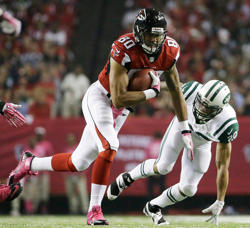 . Atlanta Falcons tight end Levine Toilolo (80) moves the ball against New York Jets cornerback Kyle Wilson (20) during the second half of an NFL football game, Monday, Oct. 7, 2013, in Atlanta. (AP Photo/David Goldman)