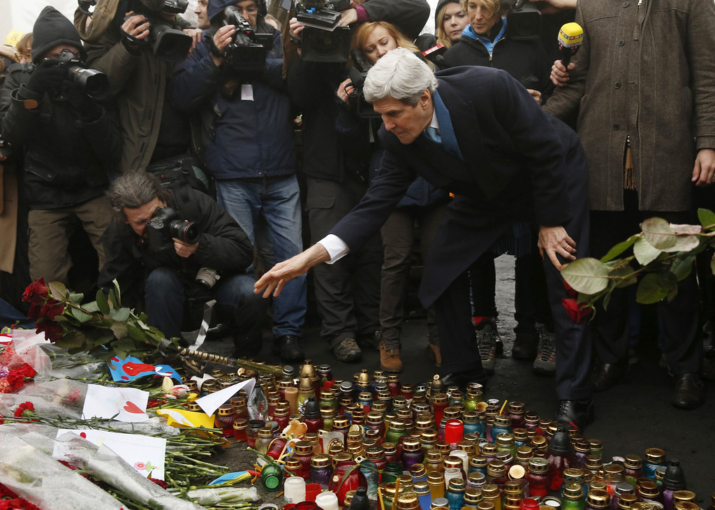 . US Secretary of State John Kerry places roses atop the Shrine of the Fallen in Kiev on March 4, 2014.  AFP PHOTO / POOL - Kevin LAMARQUE/AFP/Getty Images