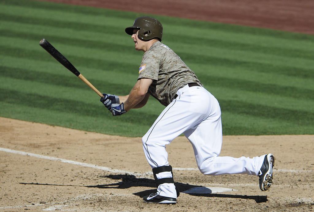 . Nick Hundley #4 of the San Diego Padres hits a three RBI double during the seventh inning of a baseball game against the Colorado Rockies at Petco Park on September 8, 2013 in San Diego, California.  (Photo by Denis Poroy/Getty Images)