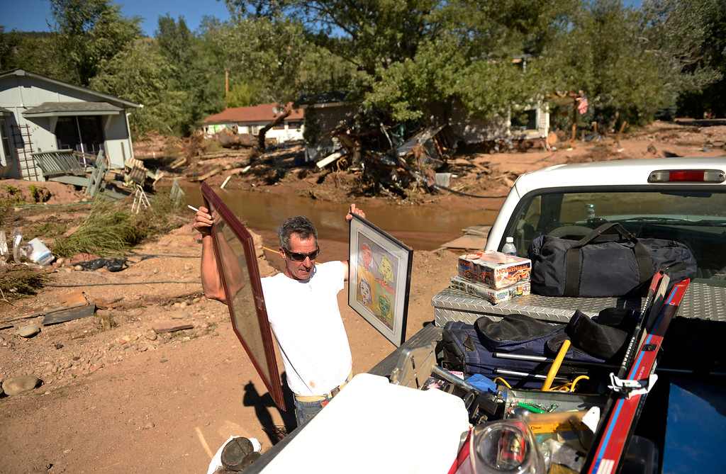 . Bob Smith loads  belongings from his destroyed home in Lyons, September 20, 2013. Residents in Lyon got to go back to the area after the massive flood destroyed much of the mountain town. (Photo By RJ Sangosti/The Denver Post)