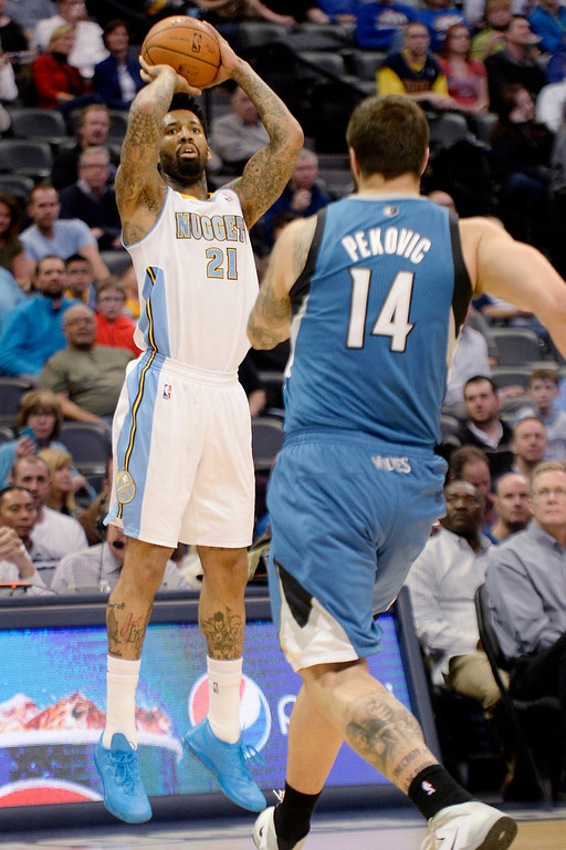 . Wilson Chandler (21) of the Denver Nuggets shoots as Nikola Pekovic (14) of the Minnesota Timberwolves defends during the first quarter at the Pepsi Center.   (Photo By AAron Ontiveroz/The Denver Post)