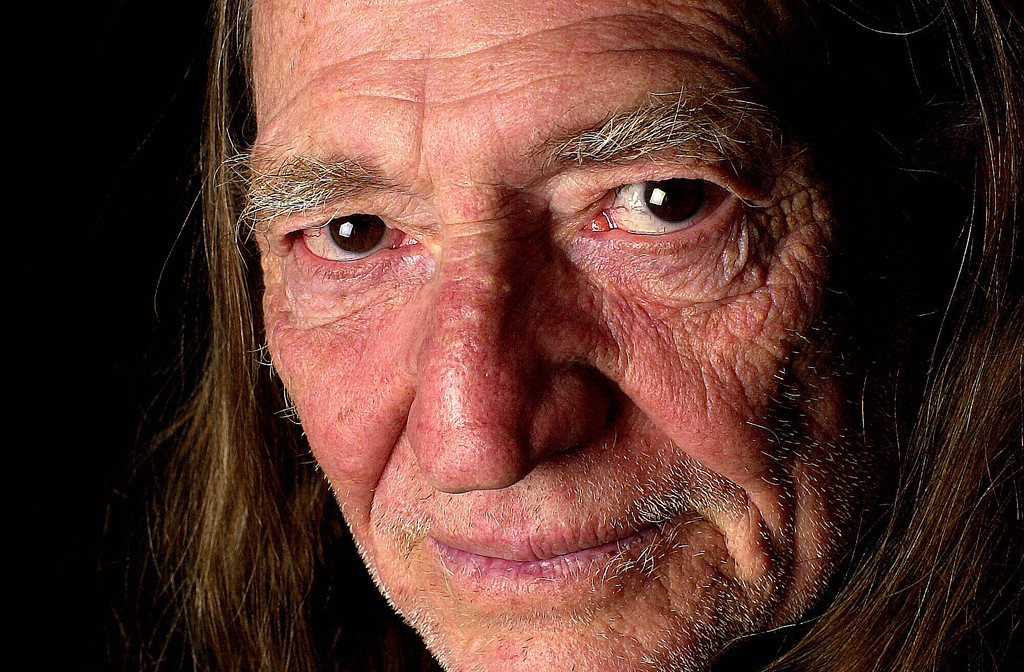 . Willie Nelson poses in a hotel in New York, Jan. 14, 2002 . (AP Photo/Gino Domenico )