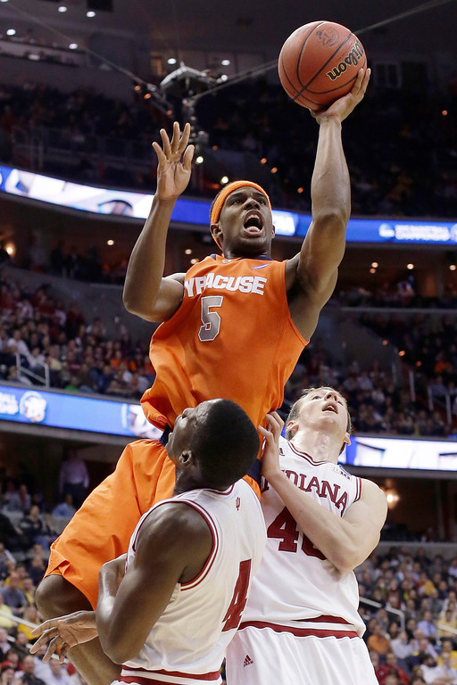 . Syracuse forward C.J. Fair (5) shoots over Indiana guard Victor Oladipo (4) and forward Cody Zeller (40) during the second half of an East Regional semifinal in the NCAA men\'s college basketball tournament, Thursday, March 28, 2013, in Washington. (AP Photo/Pablo Martinez Monsivais)