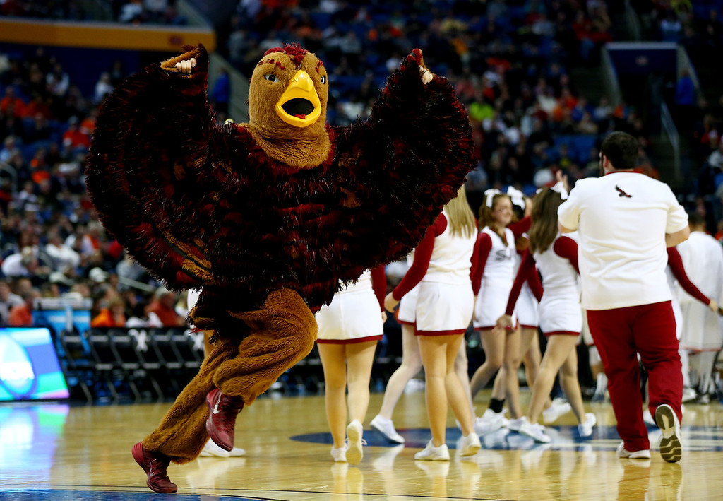 . BUFFALO, NY - MARCH 20: The Saint Joseph\'s Hawks mascot perofrms during the second round of the 2014 NCAA Men\'s Basketball Tournament against the Connecticut Huskies at the First Niagara Center on March 20, 2014 in Buffalo, New York.  (Photo by Elsa/Getty Images)