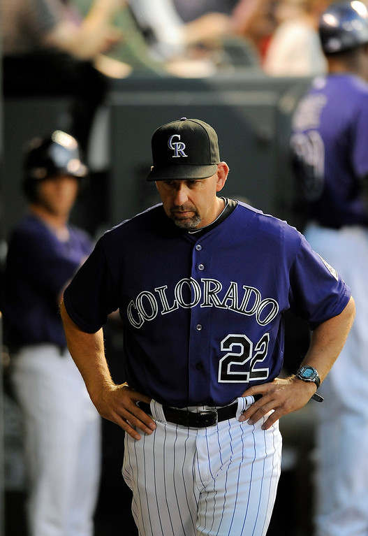 . Colorado Rockies manager Walt Weiss stands in the dugout in the fourth inning of a baseball game against the Atlanta Braves on Monday, June 9, 2014, in Denver. (AP Photo/Chris Schneider)