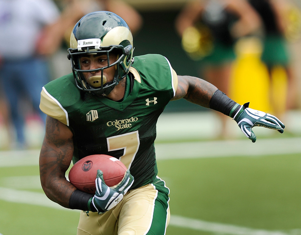 . FORT COLLINS, CO. - SEPTEMBER 14: CSU running back Donnell Alexander (7) took the ball in for a touchdown in the first half. The Colorado State University football team defeated Cal Poly at Hughes Stadium in Fort Collins Saturday afternoon, September 14, 2013.  It was the Rams\' first home game and first win of the season. Photo By Karl Gehring/The Denver Post