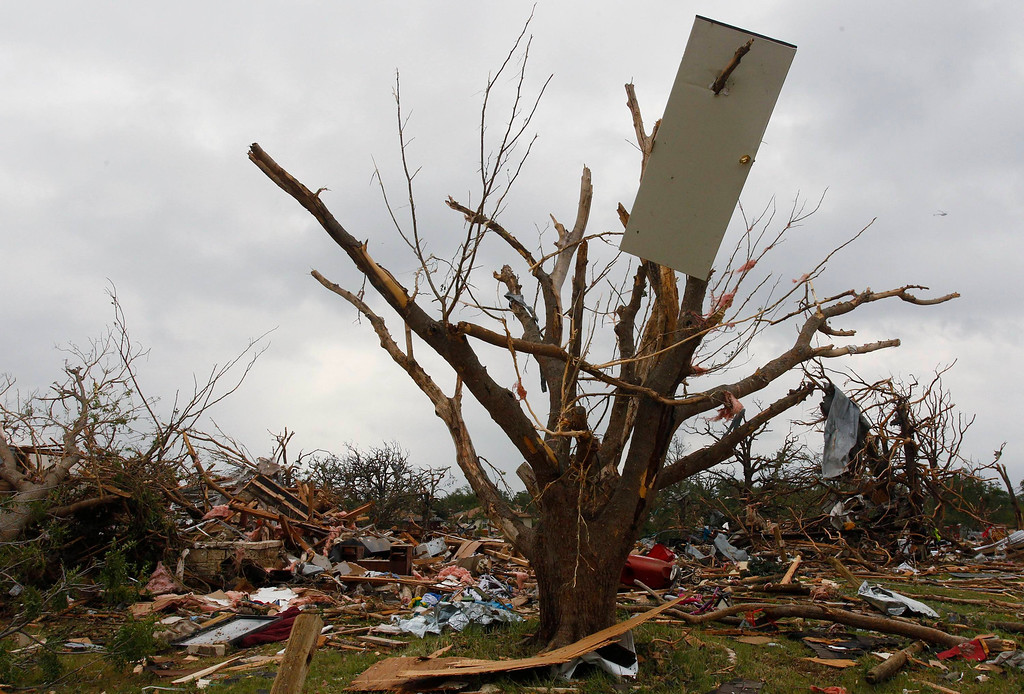 . The door of a house is impaled on a tree May 16 after tornados swept through the town of Granbury, Texas late May 15, 2013. REUTERS/Richard Rodriguez