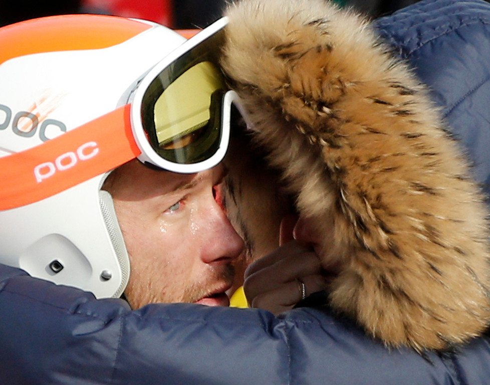 . Men\'s super-G joint bronze medal winner Bode Miller of the United States is consoled by his wife, Morgan, at the Sochi 2014 Winter Olympics, Sunday, Feb. 16, 2014, in Krasnaya Polyana, Russia. (AP Photo/Christophe Ena)